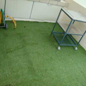Artificial Grass Laid Across The Backyard