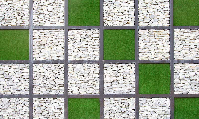 artificial grass and white pebbles formation