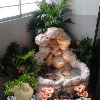custom-made water feature - plants around the rock formation display