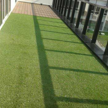 half wood flooring and half artificial grass flooring