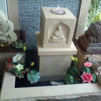 indoor water feature with the statue of Buddha