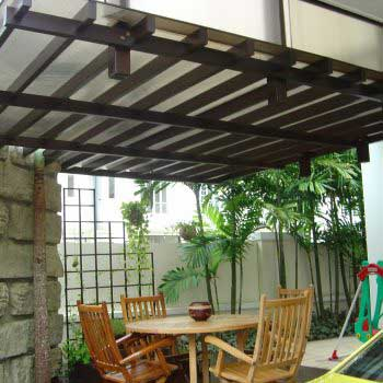 Outdoor Timber Trellis With Wooden Chairs And Table
