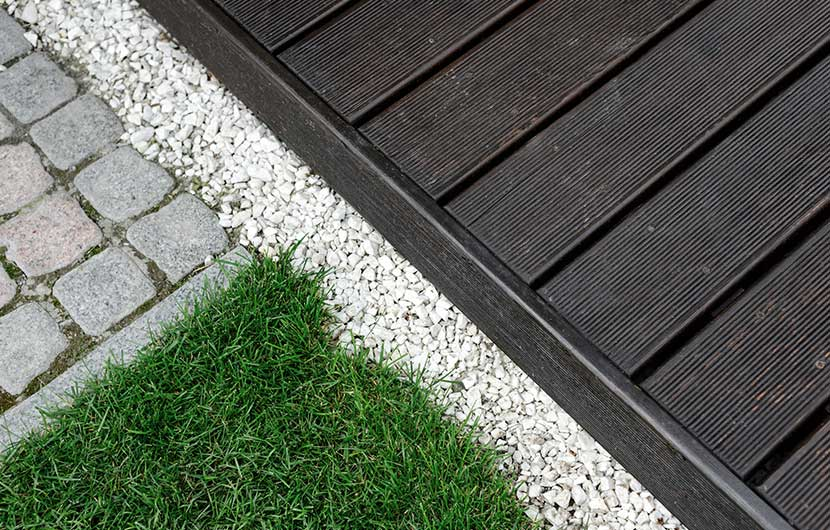 Timber decking deck and artificial grass