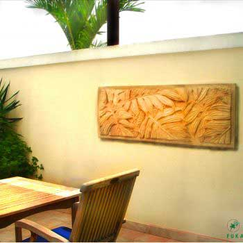 stylish wall carving and a rattan table set