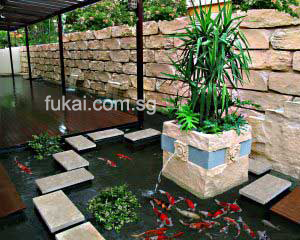 custom made koi pond with koi fishes inside